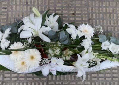 Centro funerario flores variadas